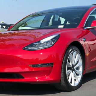 Red Tesla Model 3 with Ceramic Pro