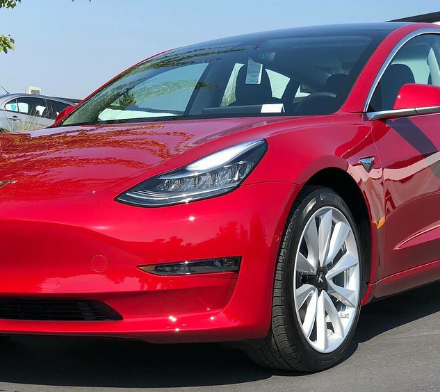 Red Tesla Model 3 with Ceramic Pro
