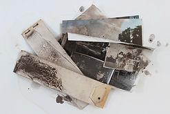 Flood damaged photographs awaiting conservation