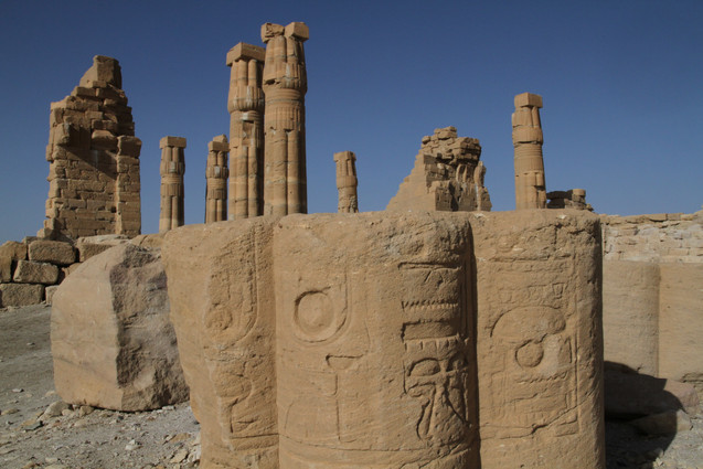 The stunning Temple of Soleb with giant sections of tumbled columns scattered in the forground