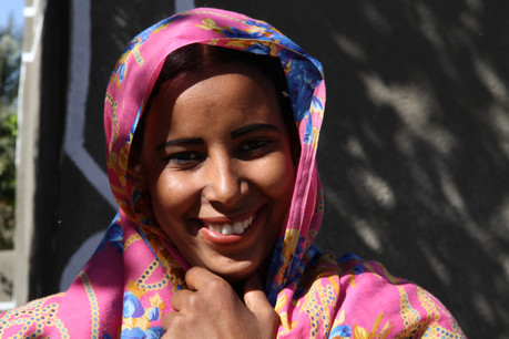An attractive Nubian lady flirts with the camera