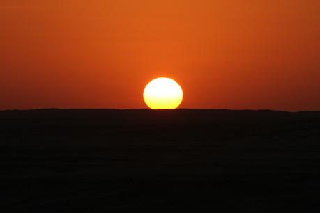 A picture postcard desert sunset