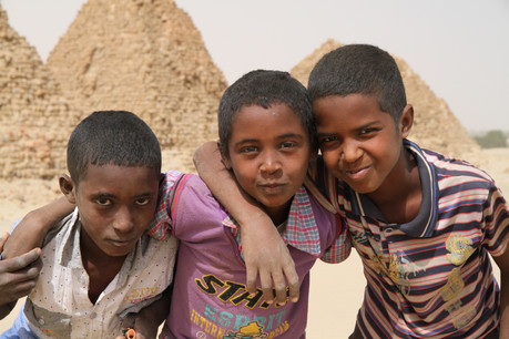 Three young boys eager to play up to the camera