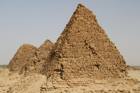 The weather worn pyramids of Nuri slowly disappearing beneath the encroaching desert sands