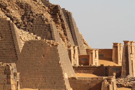 A pyramid complex majestically sited in the desert at Meroe