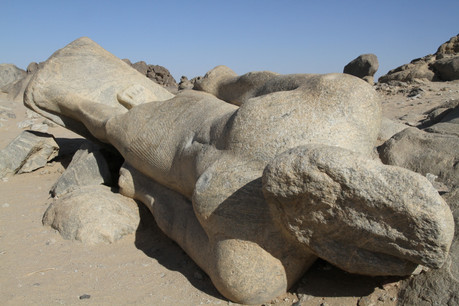 The forlorn giant statue of King Taharqa lies almost forgotten in a quarry at Tombos