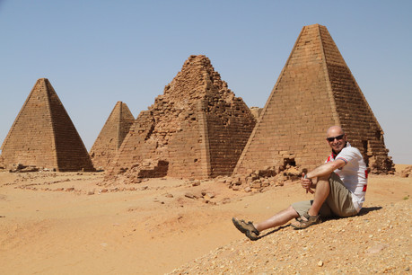 Your author and photographer poses in front of the Royal Cemetery pyramids of Karima