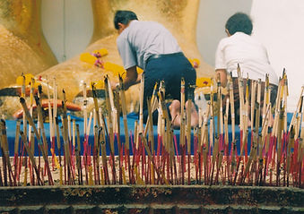 Incense sticks offered up by the faithful