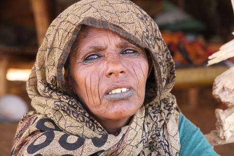 This tribal elder proudly displays the traditional facial scaring common in desert nomad culture
