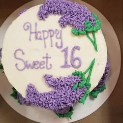 Vanilla cake with liliac flowers