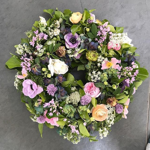 A spring wreath funeral tribute with the