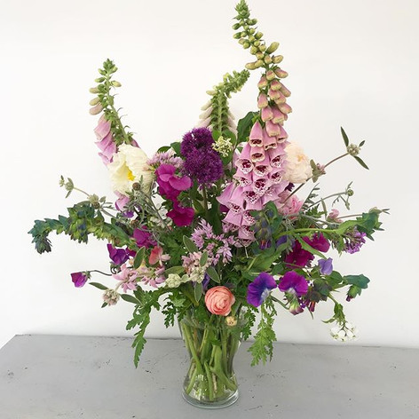 Foxgloves, alliums, sweet peas, poppies