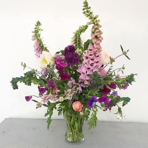 Foxgloves, alliums, sweet peas, poppies