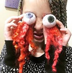 Hanging wool felted eyeball ornaments by Sharon Jong, artist of Edmonton, Alberta