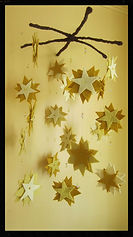 Falling stars mobile, wool felt by Sharon Jong, artist of Edmonton Alberta