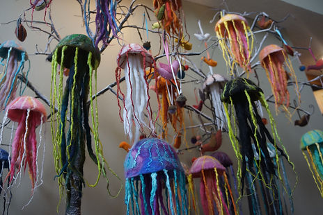 Hanging all wool handfelted jellyfish ornaments by Sharon Jong, artist of Edmonton, Alberta