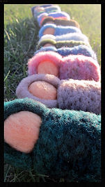 Bunting babies, all wool hand felted soft sculpture 3d needlefelted dolls by Sharon Jong, artist of Edmonton, Alberta