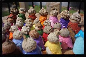 Wooden rainbow acorn gnomes by Sharon Jong, artist of Edmonton, Alberta