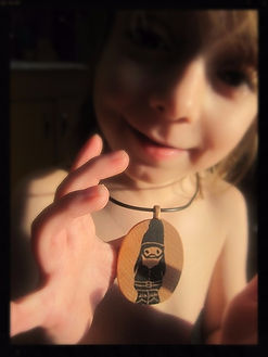 Wooden handstamped necklaces by Sharon Jong, artist of Edmonton, Alberta