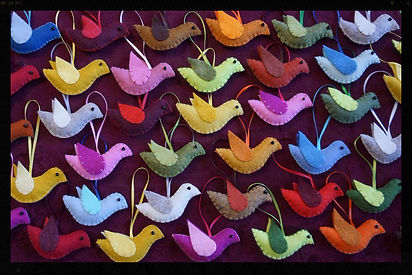 Hanging wool felt bird ornaments by Sharn Jong, artist in Edmoton, Albeta