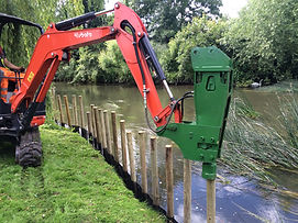 Bank protection - hydraulic post driver being used on end