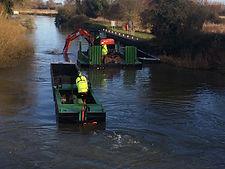 Waterway Dredging - Wide beam digger pontoon with excavation