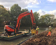 wide beam digger pontoon being used with