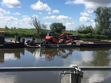 Pushing power! Tug makes light work of river