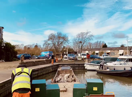 Work boat moving rip rap in recent flooding