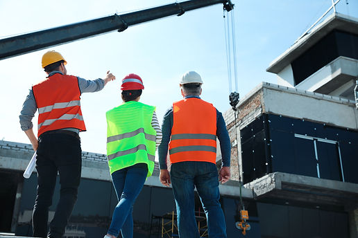 Professional engineers in safety equipme