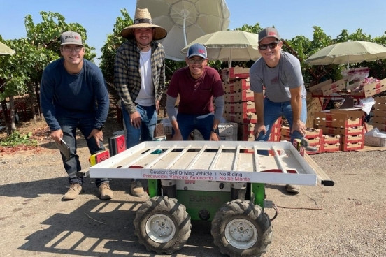 Charlie Anderson, CEO of Burro, with field workers at grape harvest