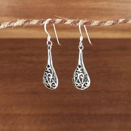 Long ornate tear drop earrings