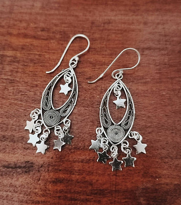 Oval filigree earrings with star charms