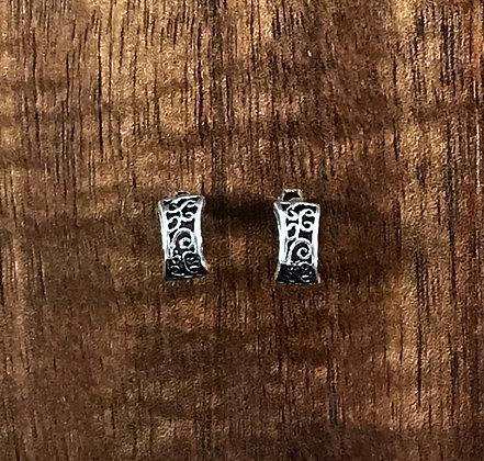 Ornate silver ear cuff studs