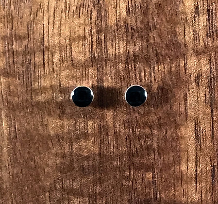 Round black ear studs. Available in 2 sizes