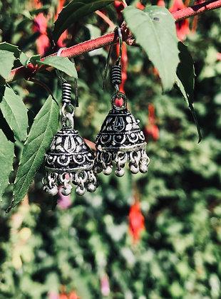 White Metal Ornate Earrings