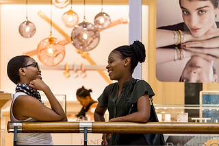 Street photography:two ladies having fun at the mall.