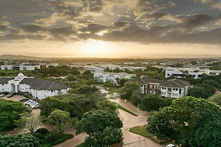 Landscape photography:beautiful sunset over verdant green office park.
