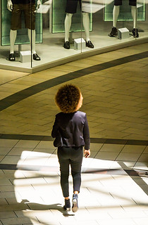 Street photography:very graphic image of African lady with huge Afro hairstyle.
