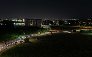 Professional architecture photography:graphic street and apartments lit up at night.