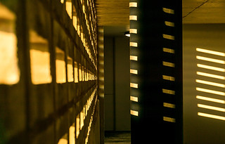 Architectural photograpy:beautiful play of yellow light against concrete.