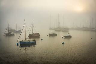 Landscape photography:beautiful misty scene of yachts and boats in Falmouth harbour.