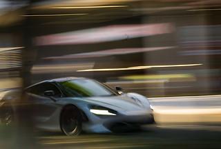 Professional car photography:fantastic image of a Mclaren F1 speeding through town.