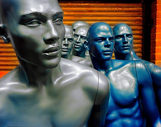 Still life photography:powerful photograph of blue and grey male mannequins shot on large format colour negative.