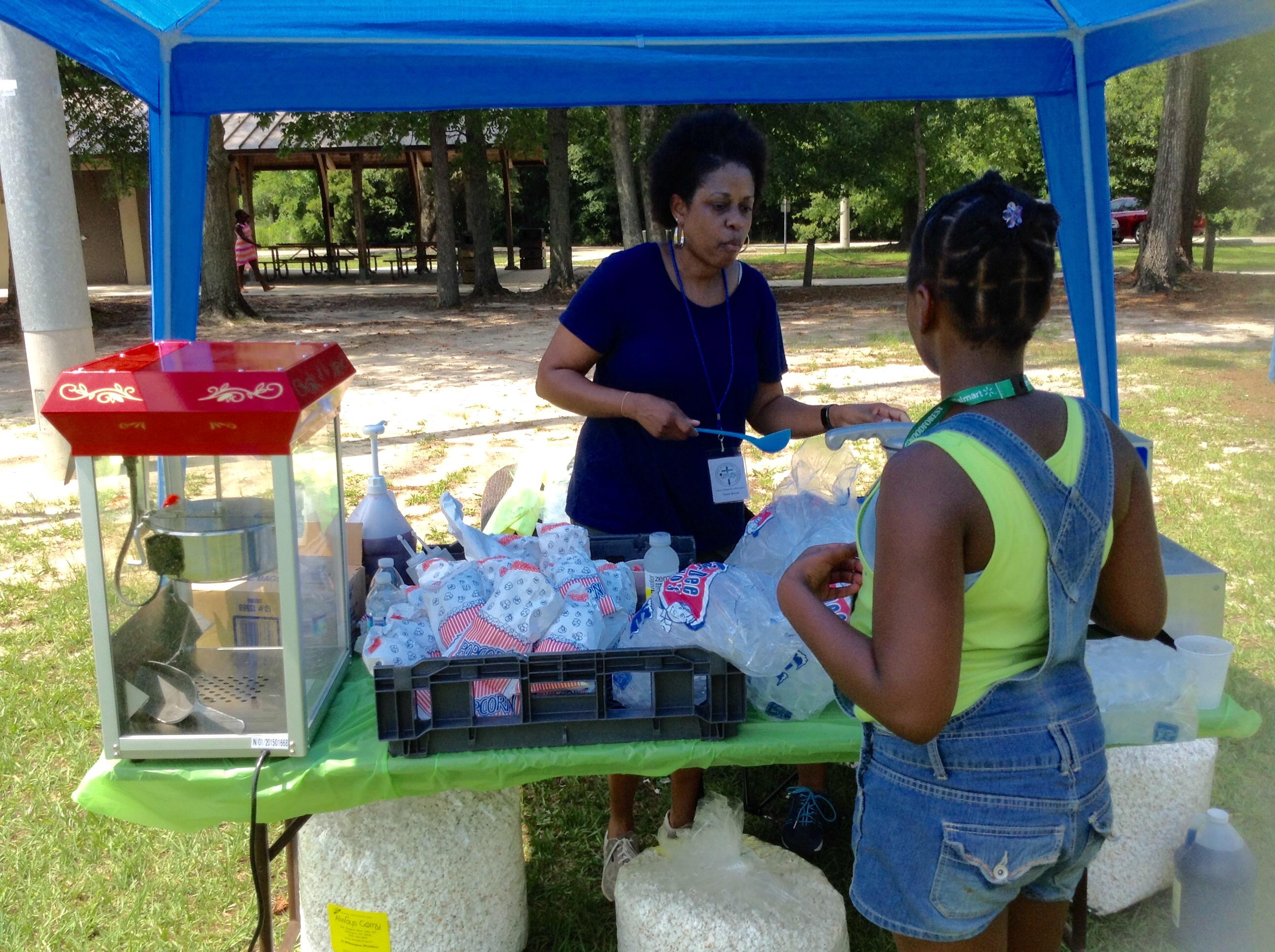 Lola Reid serving Ice Cones