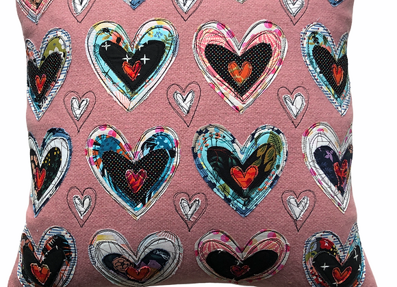 pink hearts collage pillow