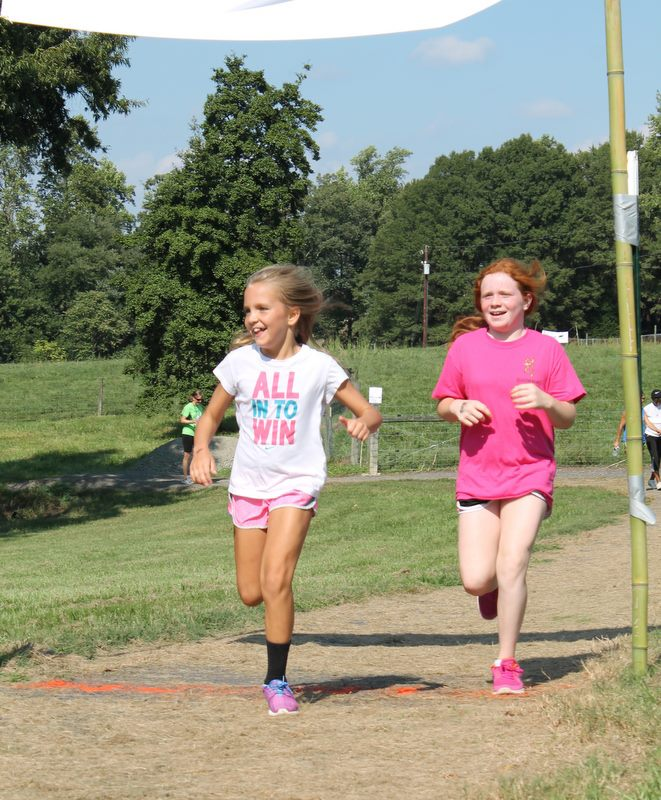 kids running on chinqua penn trail