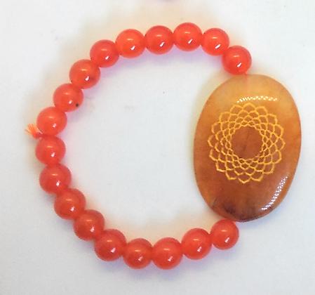 Sahasrara Symbol Engraved Crystal Bracelet: Carnelian