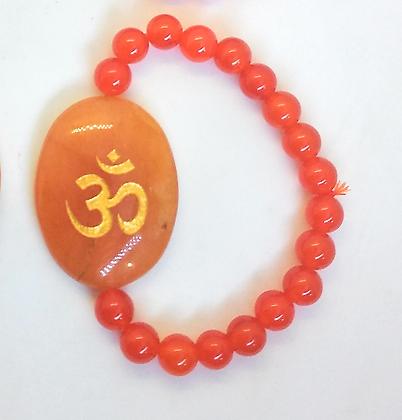 OM Symbol Engraved Crystal Bracelet: Carnelian