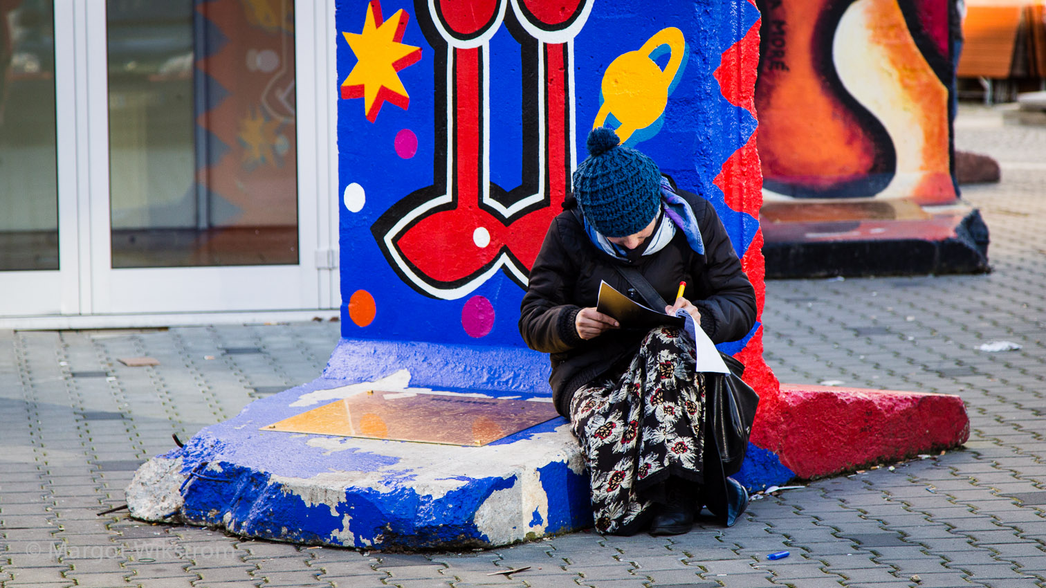 Lady Writing on Berlin Wall